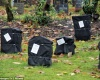 Произвол в Норвегии: сотни надгробий покрыты черными мешками